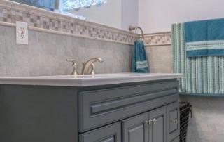 bathroom with modern bathroom and dark cabinets