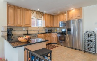light kitchen with stainless steel appliances