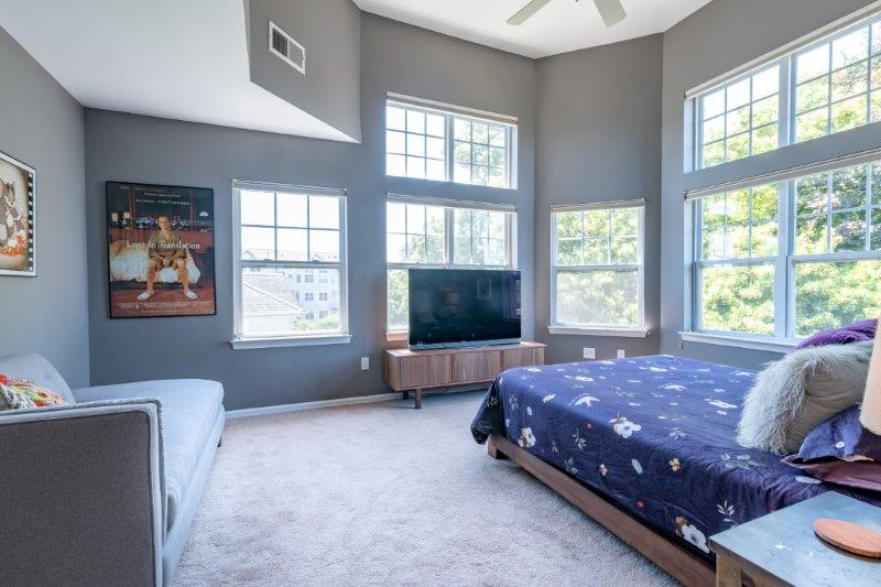 grey bedroom with large windows