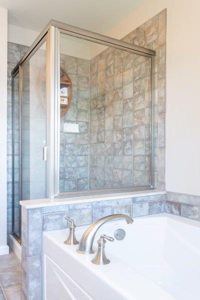 tub and shower in modern bathroom