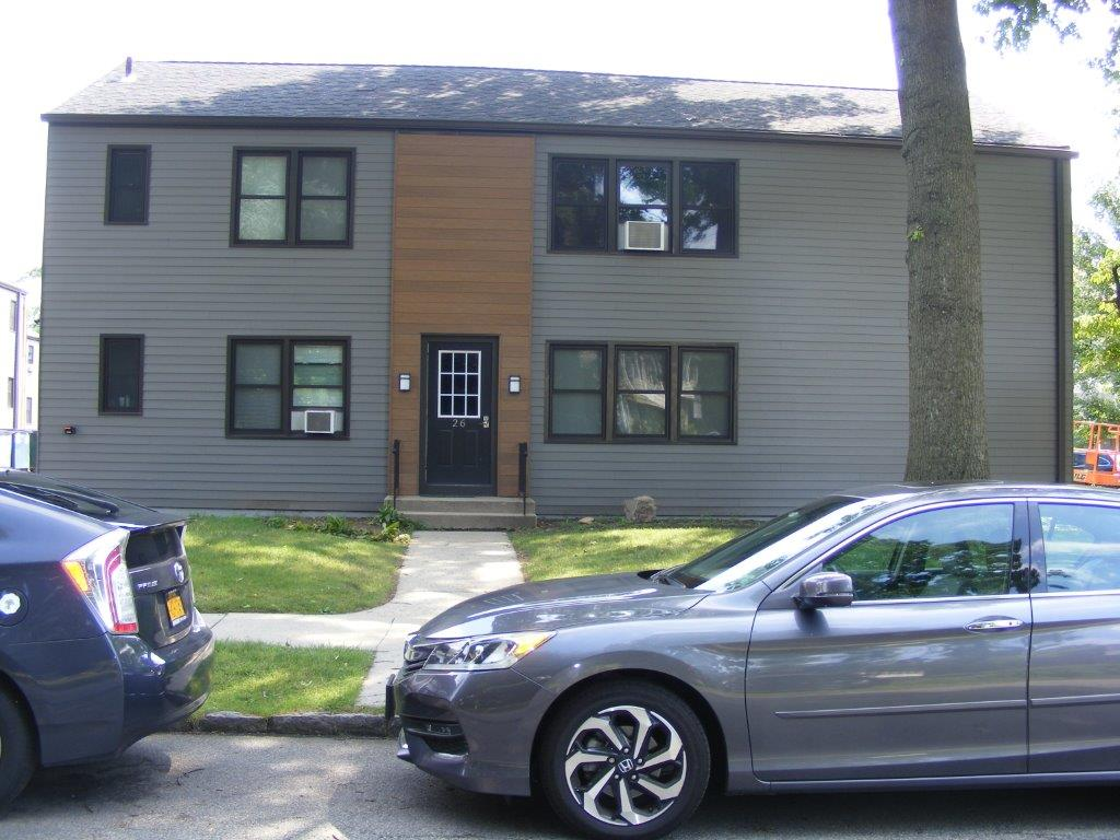exterior of the home with wood and siding
