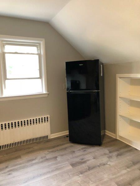 fridge in an attic room