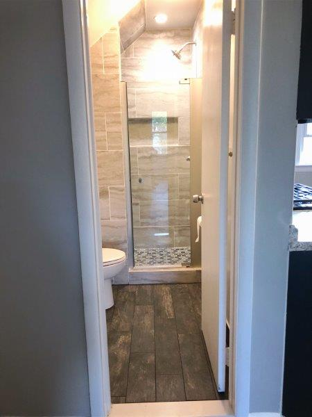 updated bathroom with a shower