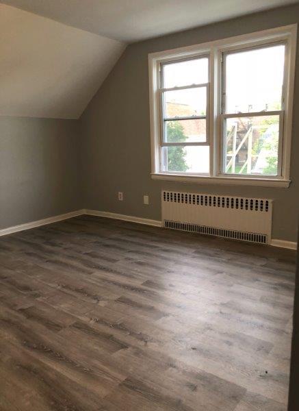 attic room with wood floors