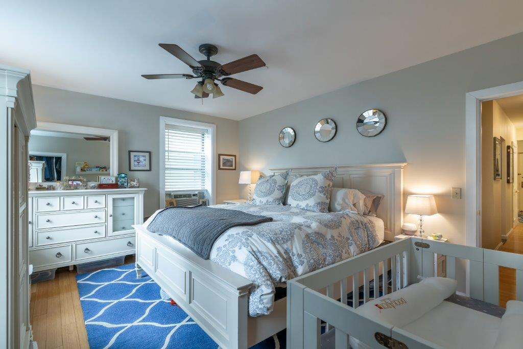 light bedroom with ceiling fan