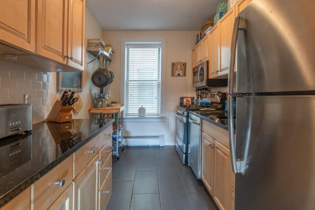 galley kitchen with stainless steel appliances